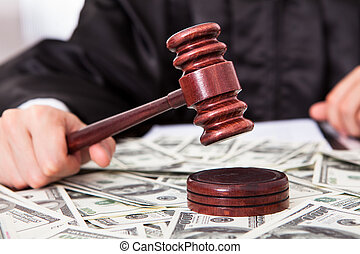Judge Hitting Mallet On Dollar - Close-up Of Male Judge...