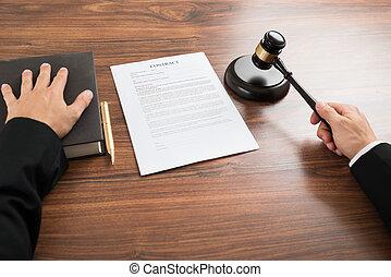 Judge Hitting The Gavel At Desk