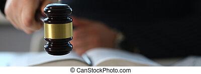 Judge holding hammer in hand lies