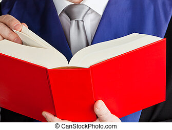 judge in court with code - a judge with a law book in court....