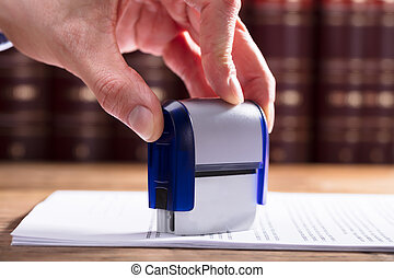 Judge Stamping Document - Close-up Of A Judge's Hand...