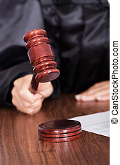 Judge Striking The Gavel In A Courtroom - Close-up Of Judge...