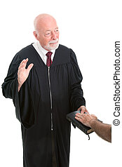 Judge - Swearing In - Judge swearing in a witness on the...