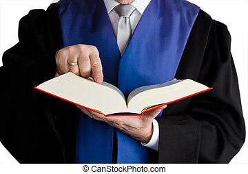 judge with code - a judge holds a law book in his hand....