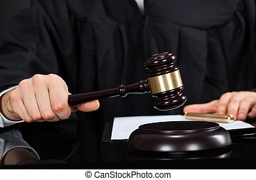 Judge With Mallet At Desk - Closeup of male judge with...