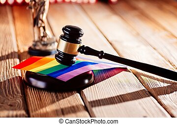 Judge wooden mallet - symbol of law and justice with lgbt rainbow colours flag