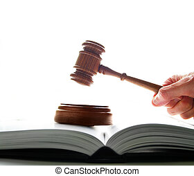 judges court gavel being pounded on a lawbook, on white...