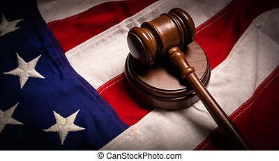 Judges gavel and an American flag -justice theme