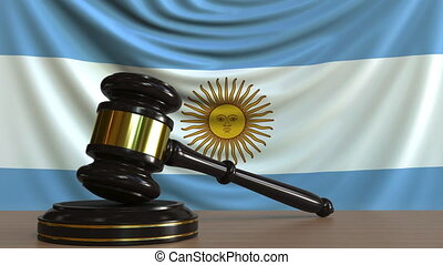 Judge's gavel and block against the flag of Argentina....