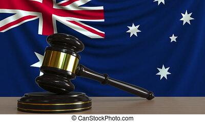 Judge's gavel and block against the flag of Australia....