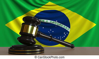 Judge's gavel and block against the flag of Brazil....