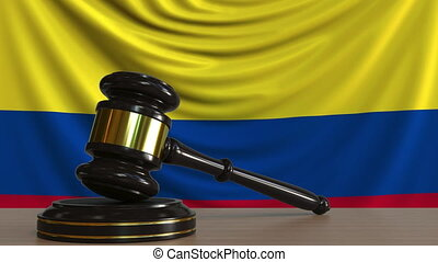 Judge's gavel and block against the flag of Colombia....