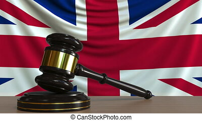 Judge's gavel and block against the flag of Great Britain....