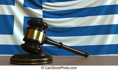 Judge's gavel and block against the flag of Greece. Greek...