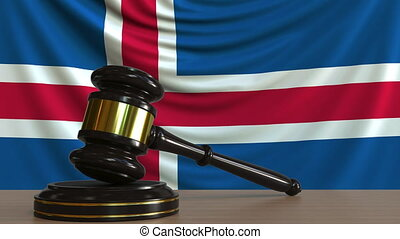 Judge's gavel and block against the flag of Iceland....