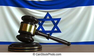 Judge's gavel and block against the flag of Israel. Israeli...