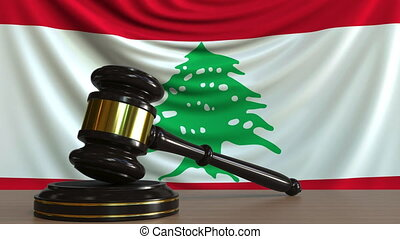 Judge's gavel and block against the flag of Lebanon....