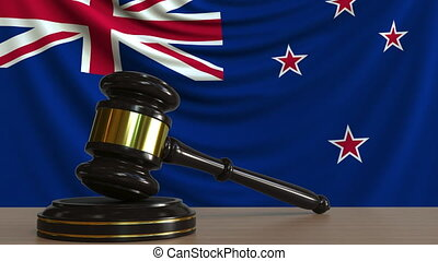 Judge's gavel and block against the flag of New Zealand....