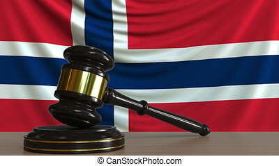 Judge's gavel and block against the flag of Norway....