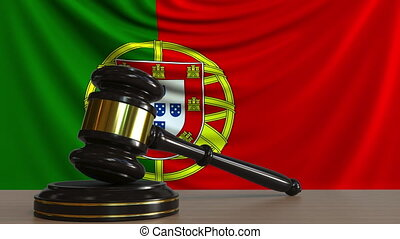 Judge's gavel and block against the flag of Portugal....