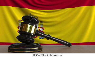 Judge's gavel and block against the flag of Spain. Spanish...