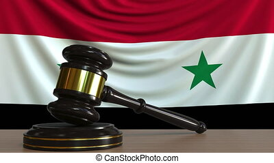 Judge's gavel and block against the flag of Syria. Syrian...