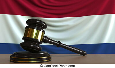 Judge's gavel and block against the flag of the Netherlands....