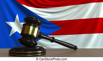 Judge's gavel and block against the flag of the Puerto Rico....