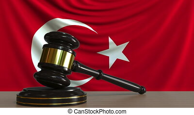 Judge's gavel and block against the flag of Turkey. Turkish...