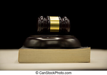 Judges gavel and book on wooden table. Law and justice concept background.