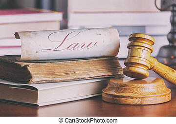 Judge's gavel and old book