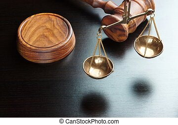 Judges Gavel And Scale Of Justice On The Black Table