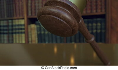 Judge's gavel falling and hitting the block with LITIGATION inscription. 4K video
