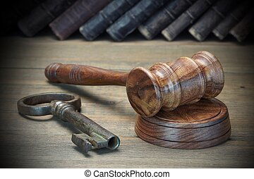 Judges Gavel, Old Key And Law Book On Wood Table