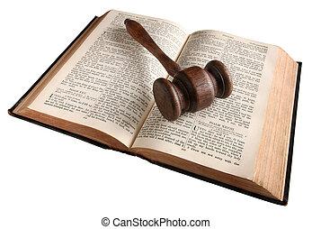 Judges gavel on Bible. - A wooden judges gavel on an 1882...