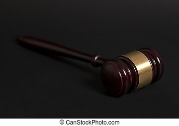 Judge's gavel on black background