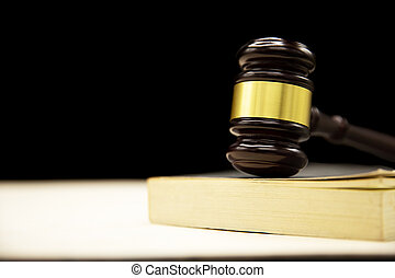 Judges gavel on book and wooden table. Law and justice concept background.