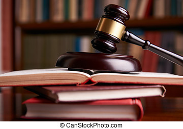 Judges gavel with law books