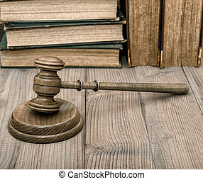 Judges gavel with soundboard old books