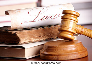 Judges gavel with very old books - Judges wooden gavel with...