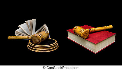 Judge's hammer and book on a black background