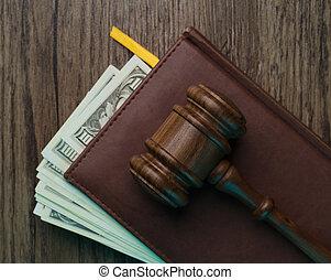 Judge's hammer, folder with money