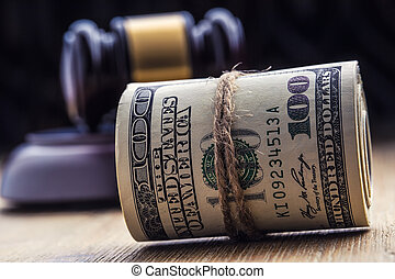 Judge's hammer gavel. Justice dollars banknotes and usa flag in the background. Court gavel and rolled banknotes. Still life of a bribery, corruption in the US judicial system