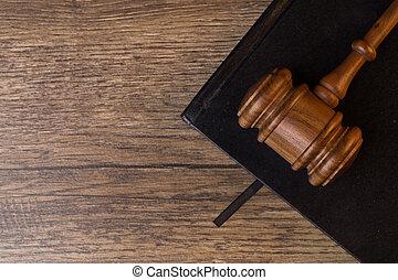 Judge's hammer l on black notepad