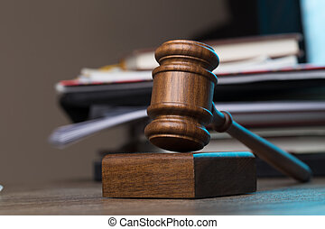 Judge's hammer lies on table