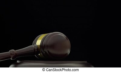 Judge's hammer turns clockwise on the stand. Black background