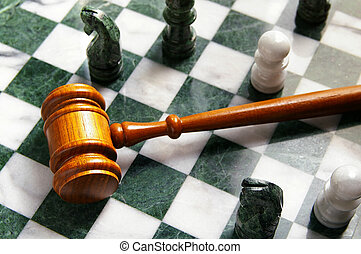 judges law gavel on a chess board, from above