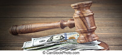 Judges or Auctioneers Gavel And Money Stack On Wooden...