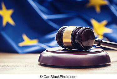 Judges wooden gavel with EU flag in the background. Symbol...