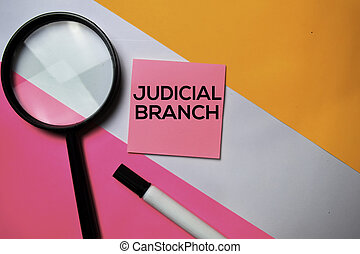 Judicial Branch text on sticky notes with color office desk concept